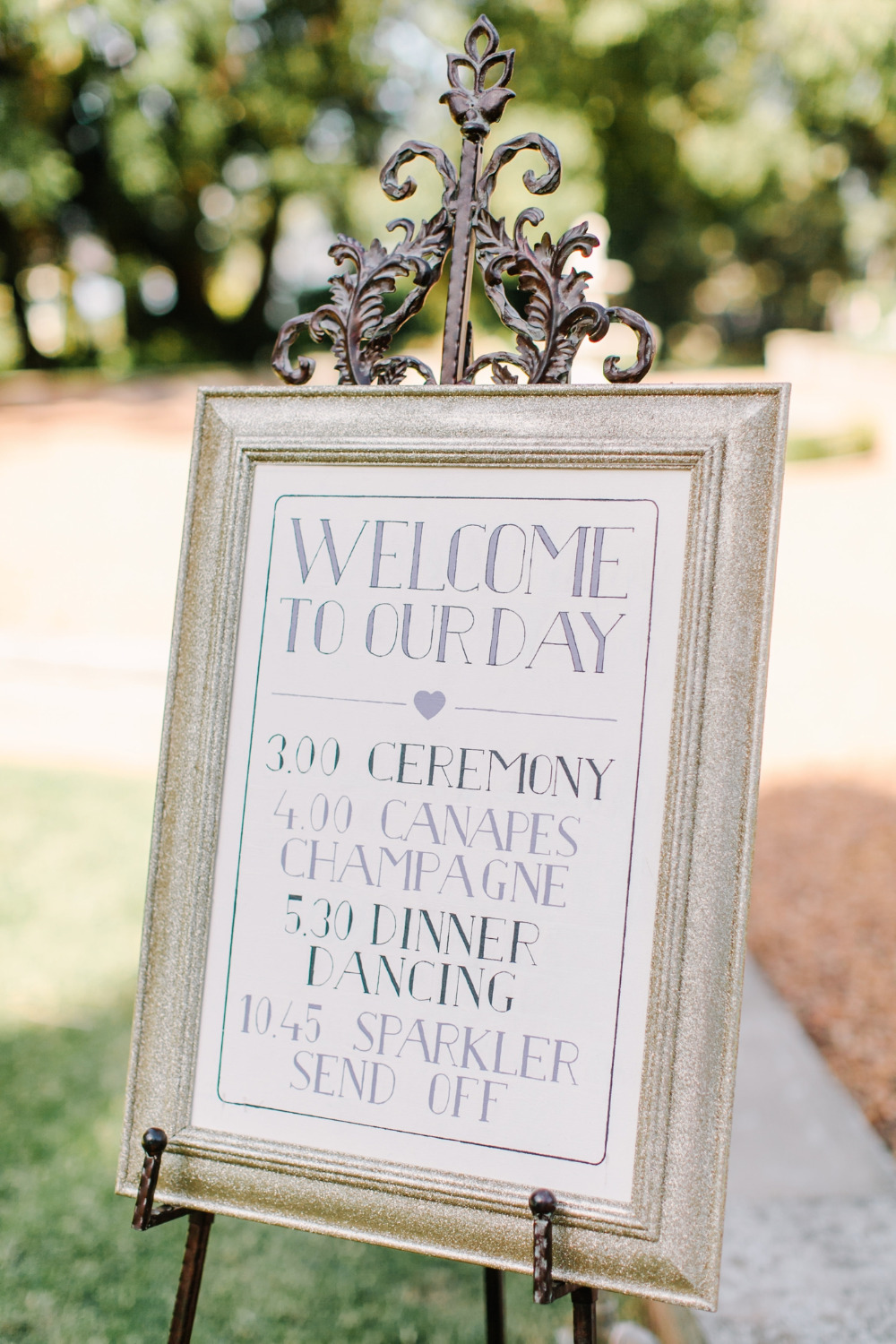 wedding welcome sign with gold glitter
