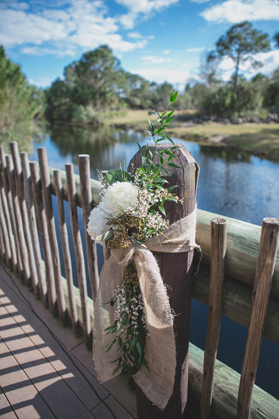 loose and organic styled flower decor wrapped in burlap