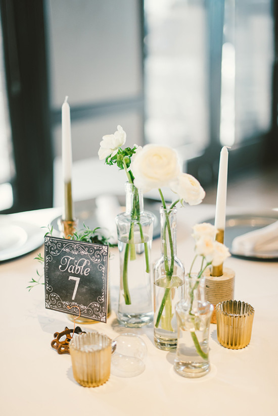 minimalist gold and white centerpiece with chalkboard style table number