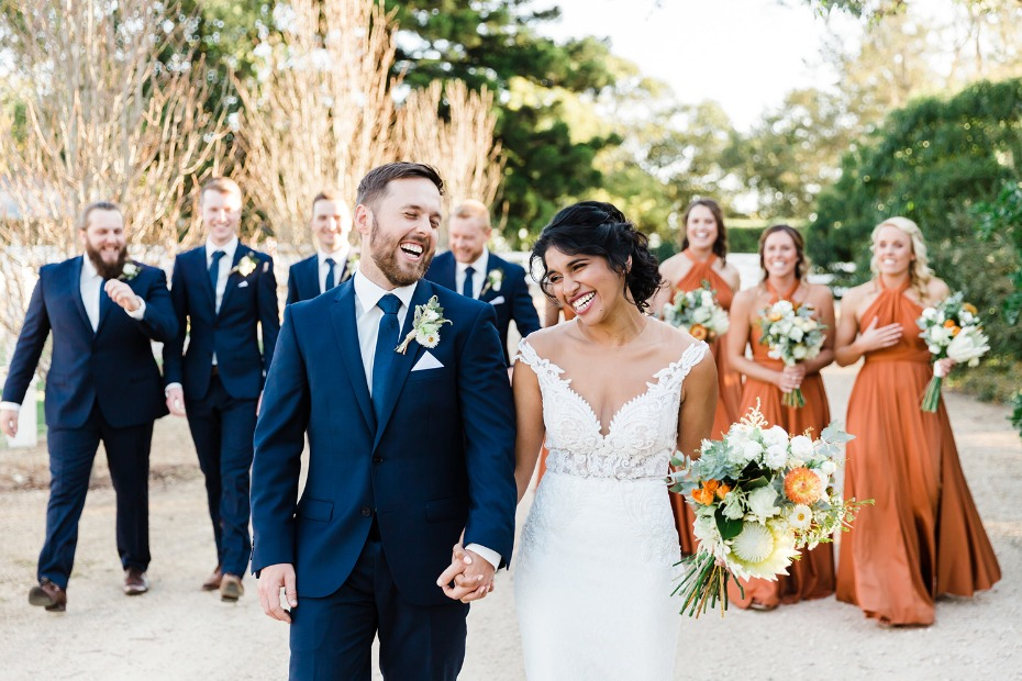 wedding party in navy and burnt orange