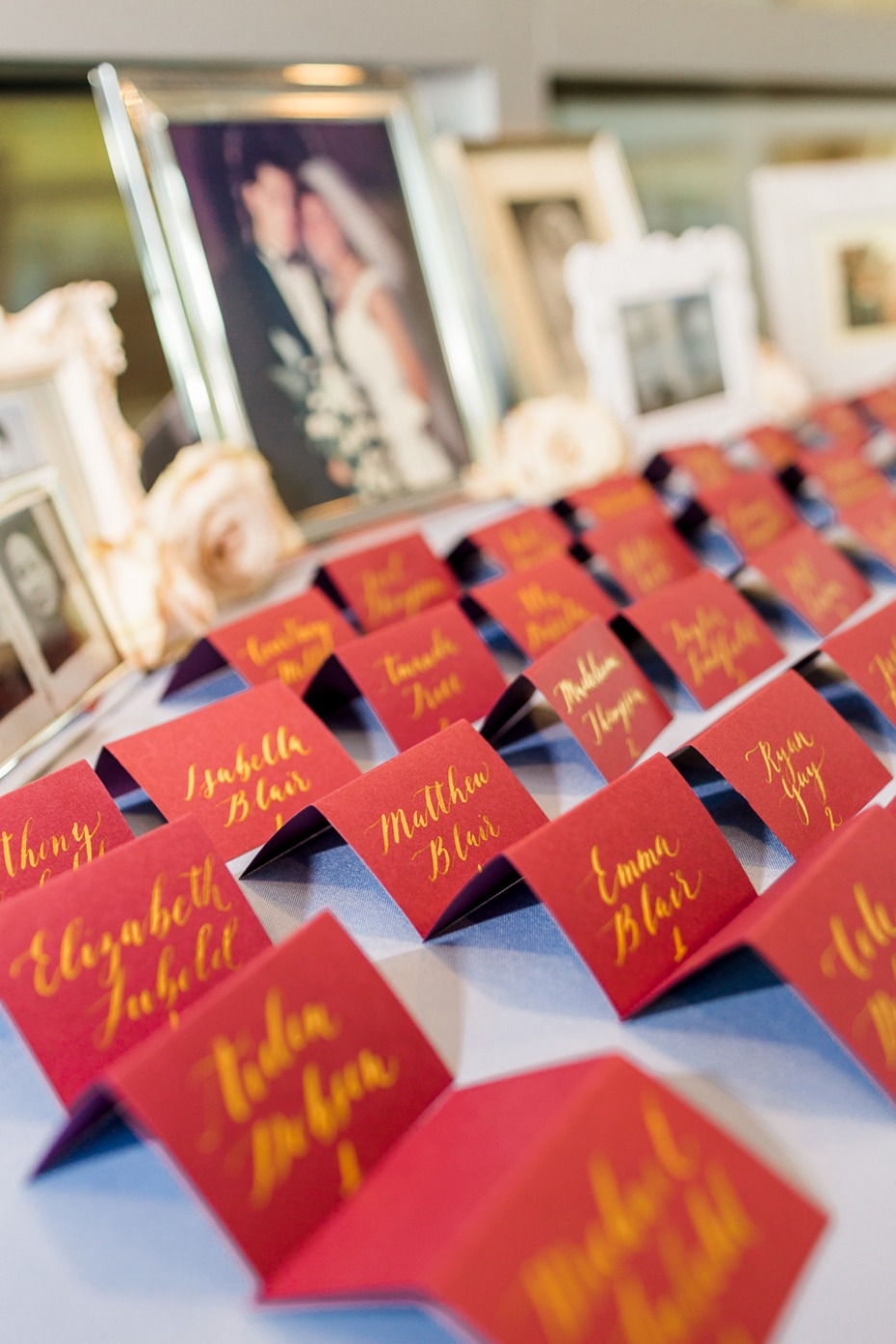 red and gold wedding escort cards