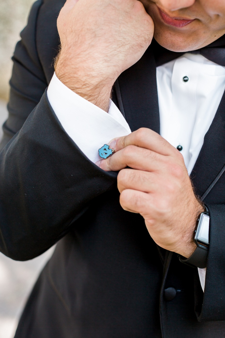 groom sporting his favorite team on his cuff links